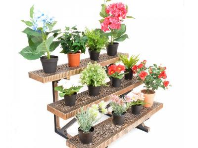 Use tiered planters in the back to maximize ground space