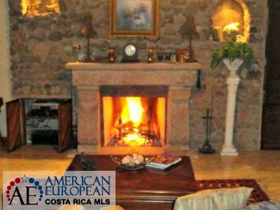 Spanish Colonial Luxury home with a fireplace