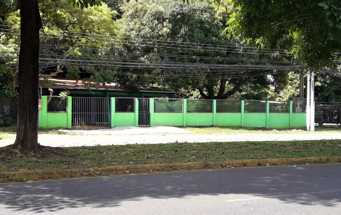 Prime Playas del Coco Main Road Building Lot with 2 Houses